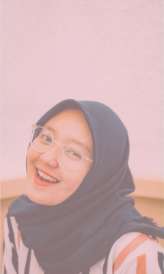 Young woman in a habib smiling and looking at the camera